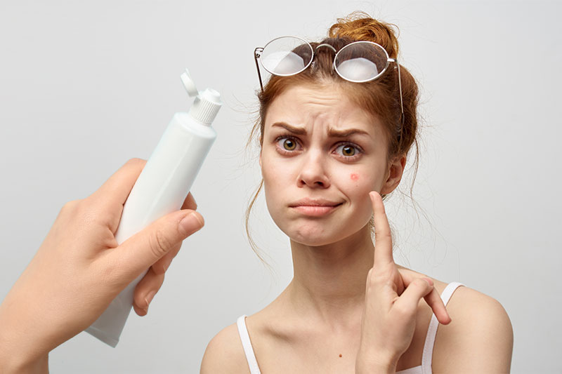 Putting Toothpaste On A Pimple Is Riskier Than You Think